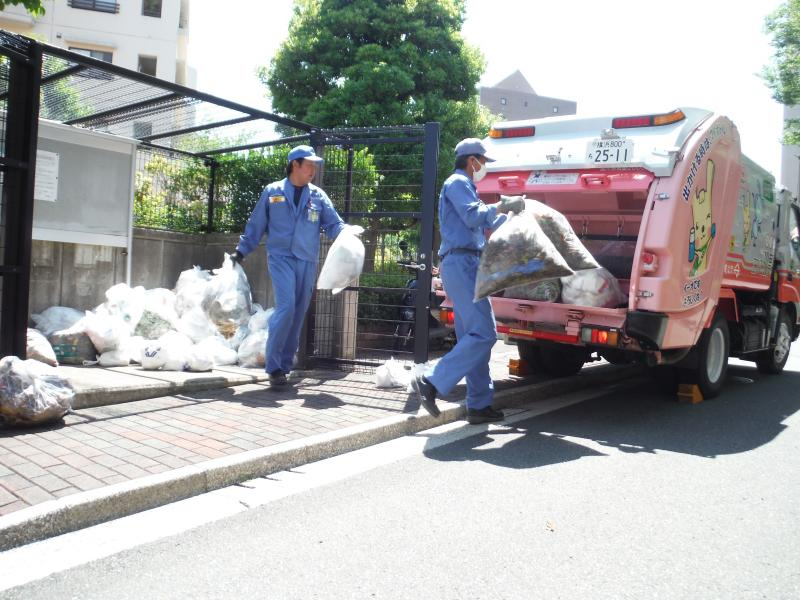 Workers collecting waste from a collection site